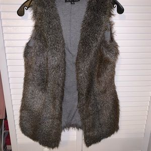 Jackets & Blazers - XS faux fur vest with pockets. Clasps up front.